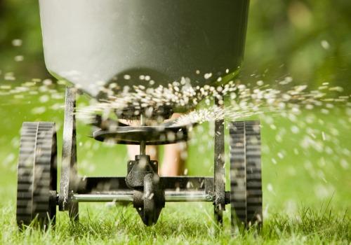 Someone spreading Lawn Fertilizer in Peoria IL